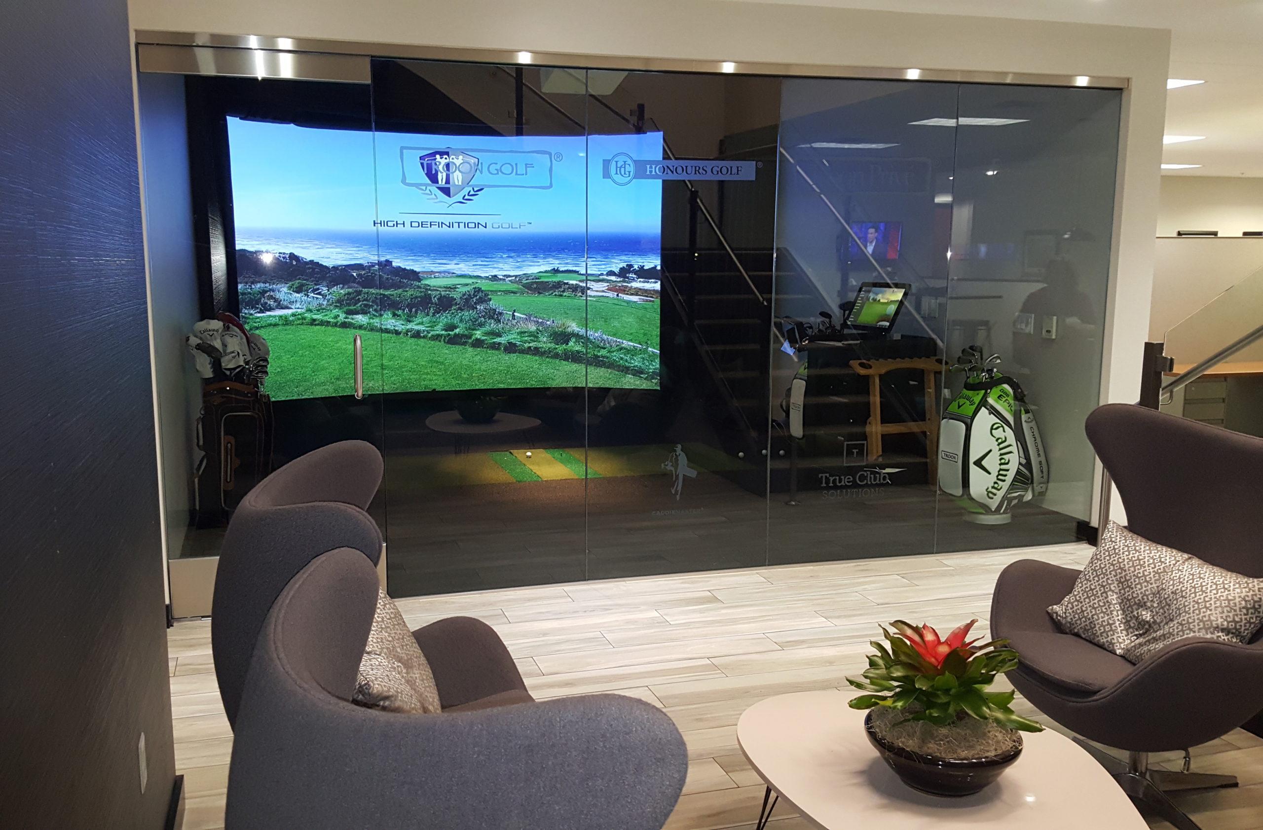 People golfing on Simulator